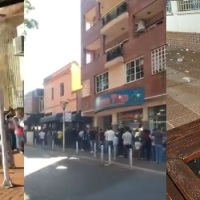 Largas colas para cobrar en el banco Nación y quejas por la basura